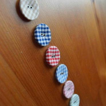 Knoflík textilní sv. modrý